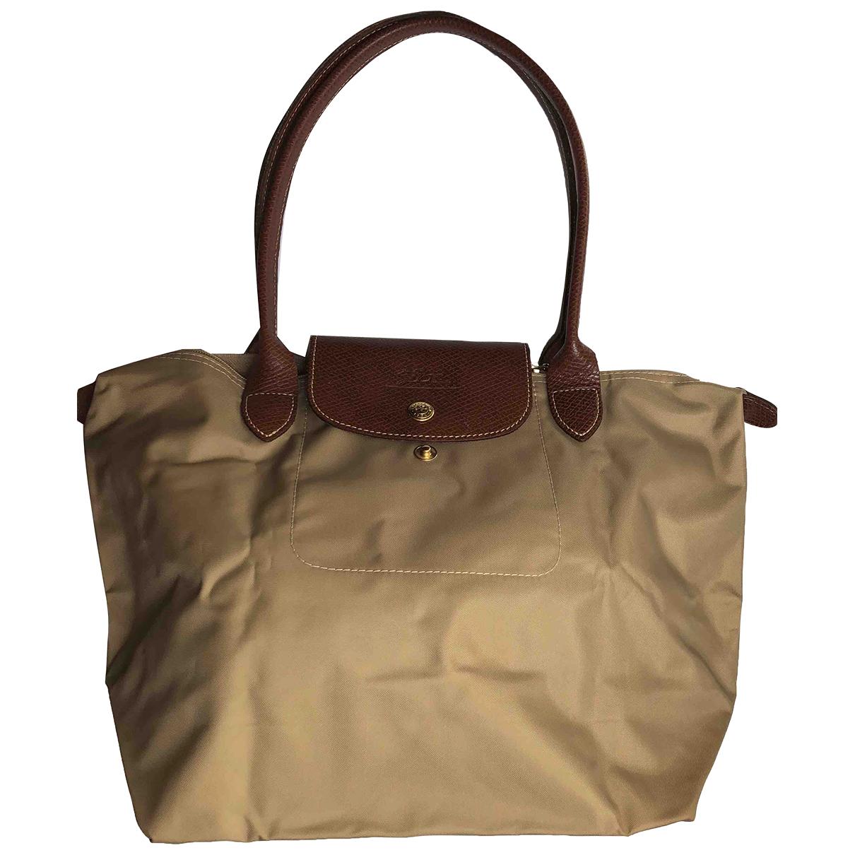 Bolsos clutch en Sintetico Beige Longchamp