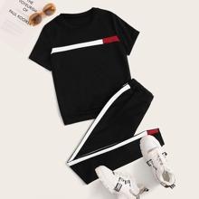 Camiseta panel en contraste con joggers de lado de rayas