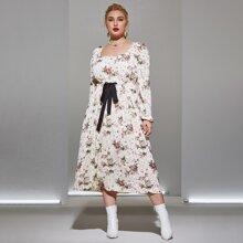 Vestido midi floral de cintura con cordon