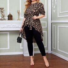Top de leopardo con cinturon bajo irregular