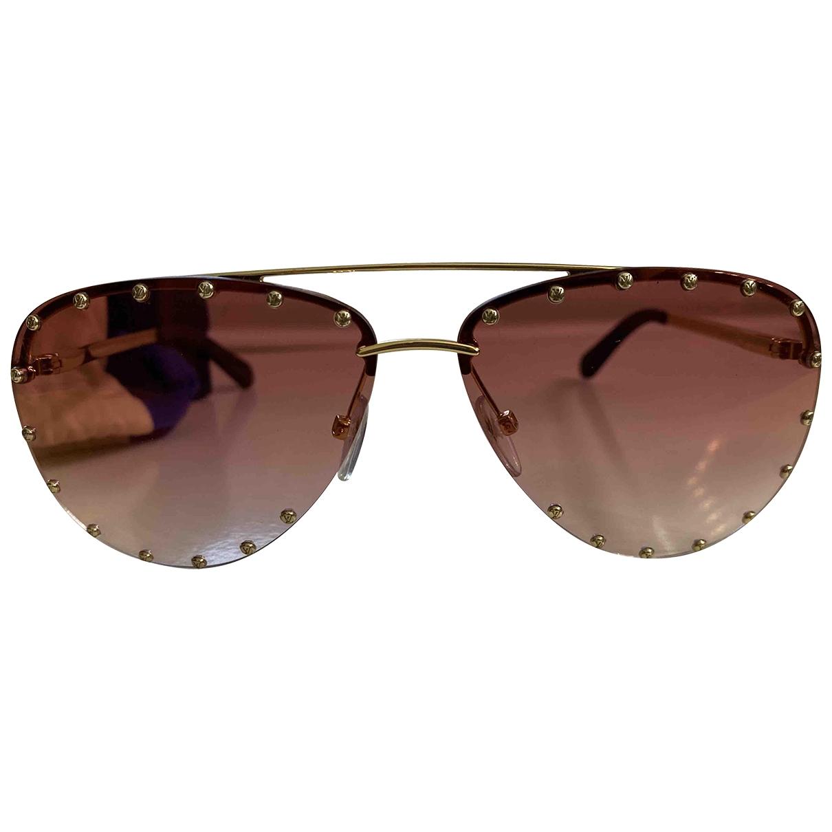 Louis Vuitton \N Sonnenbrillen in  Rot Metall