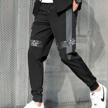Pantalones deportivos de hombres de cintura con cordon panel en contraste