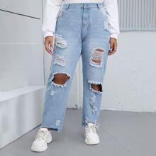 Einfarbige Jeans mit Riss und geradem Beinschnitt