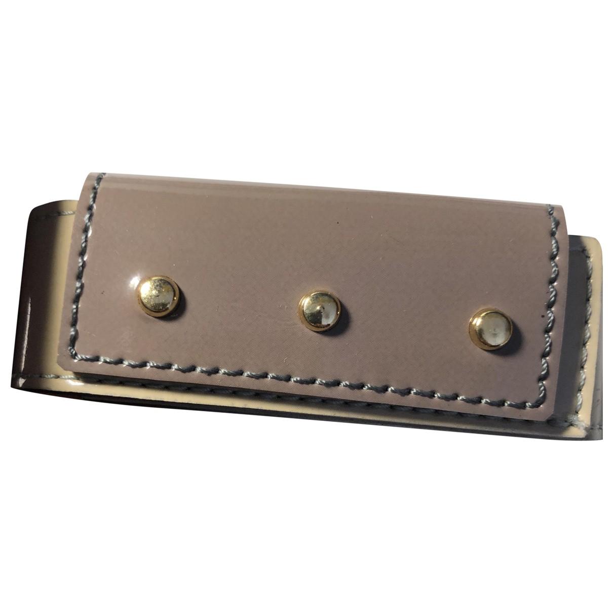 - Bracelet   pour femme en cuir verni - beige