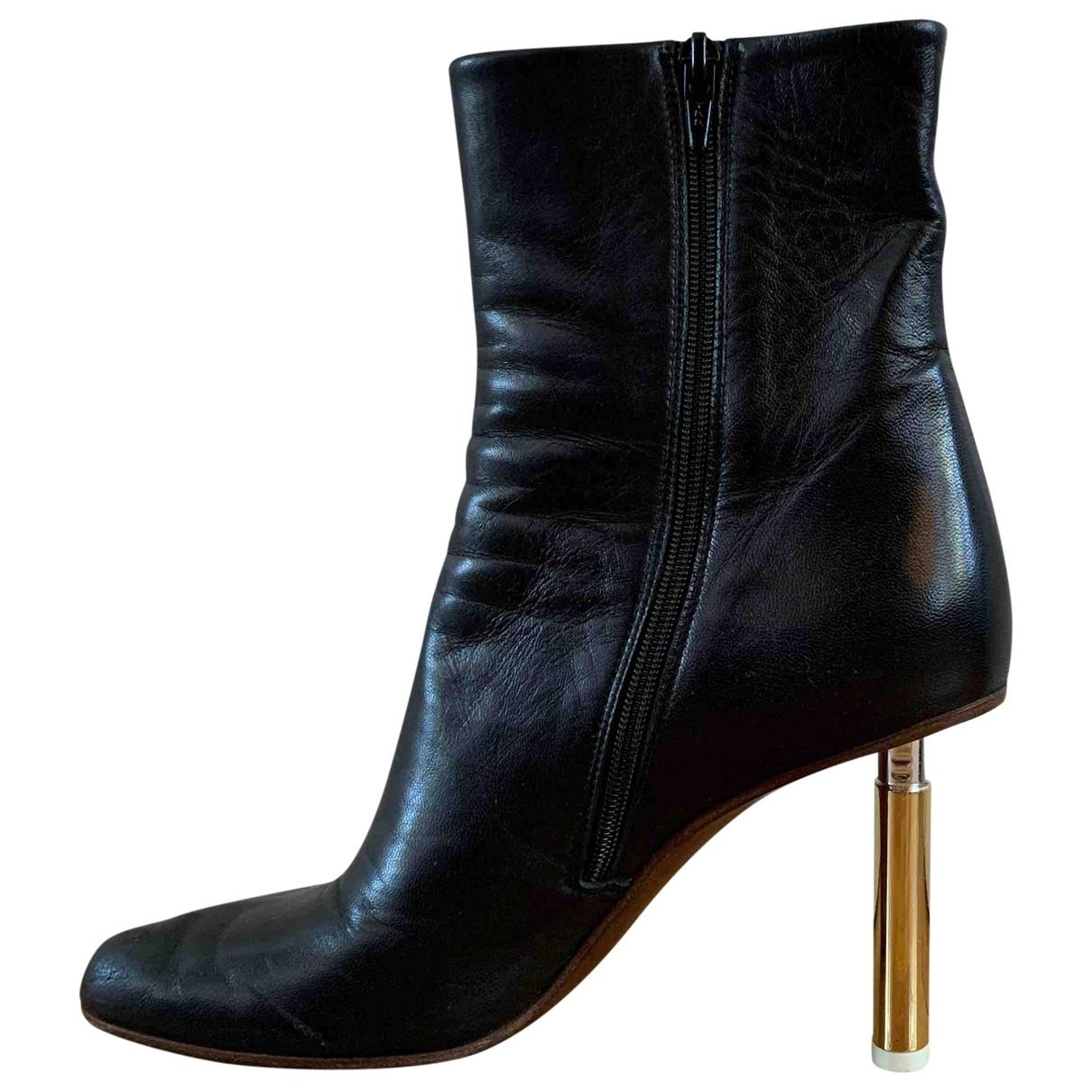 Vetements - Boots   pour femme en cuir - noir