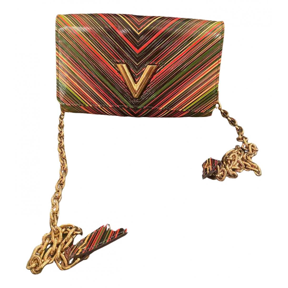 Louis Vuitton Twist Clutch in Leder
