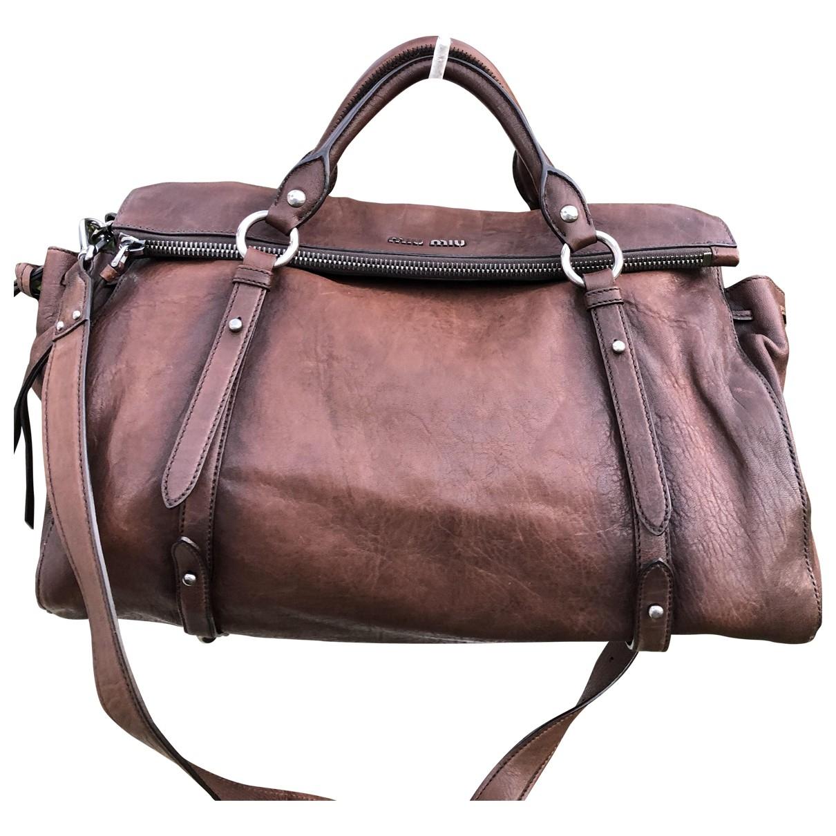 Miu Miu Bow bag Handtasche in  Braun Leder