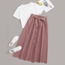 Camiseta unicolor con falda con boton delantero con lazo