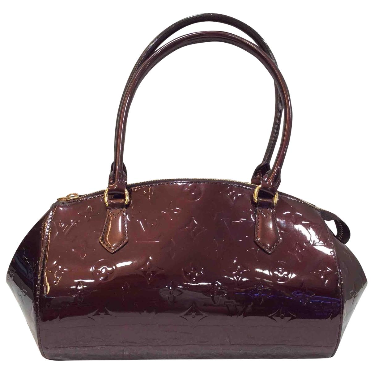 Louis Vuitton - Sac a main   pour femme en cuir verni - bordeaux