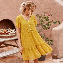 Kleid mit Punkten Muster und Knopfen vorn