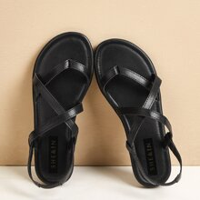 Sandalen mit Zehenpfosten und Kreuzgurt
