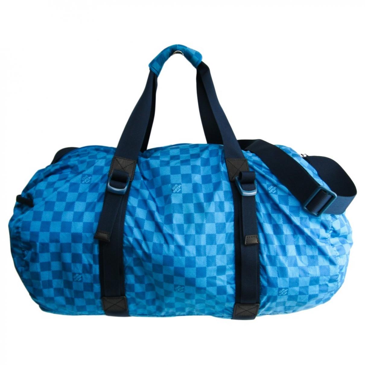 Louis Vuitton \N Blue Cloth bag for Men \N