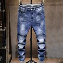 Jeans mit Reissverschluss, Riss und Waschung