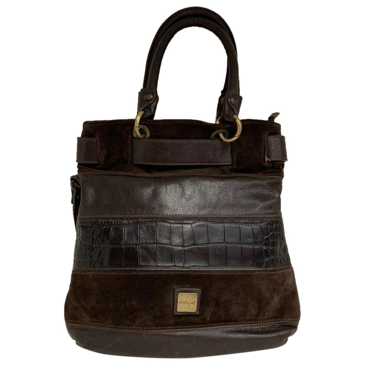 Innue \N Handtasche in  Braun Leder