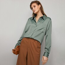 Camisa con bolsillo con puntada en contraste