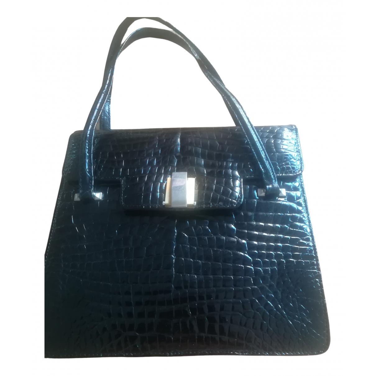 Non Signé / Unsigned \N Black Crocodile handbag for Women \N