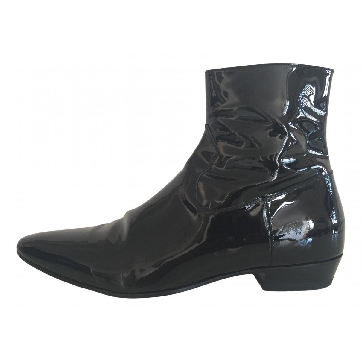 Saint Laurent - Bottes.Boots   pour homme en cuir verni - noir