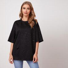 T-Shirt mit Riss Detail, sehr tief angesetzter Schulterpartie und Glitzer