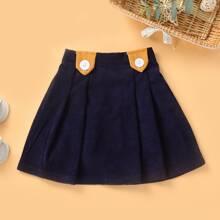 Falda de pana con boton