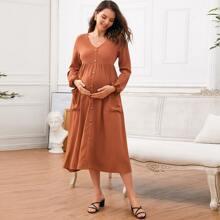 Umstandsmode Kleid mit einreihiger Knopfleiste und Taschen vorn