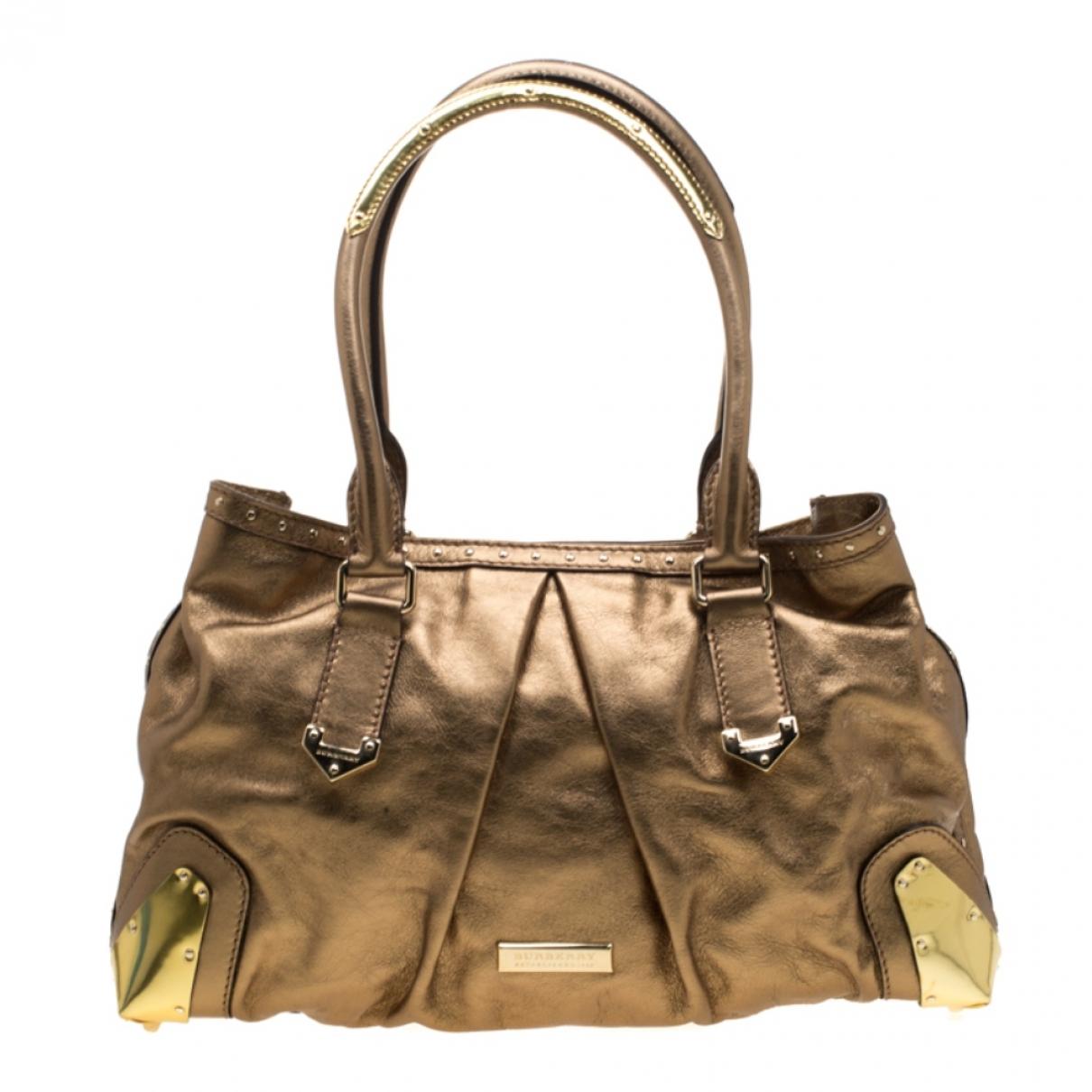 Burberry \N Handtasche in  Gold Leder
