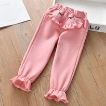 Pantalones amplios ribete con fruncido con bordado