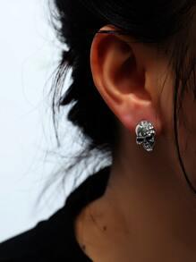 Ohrringe mit Strass und Schaedel Dekor