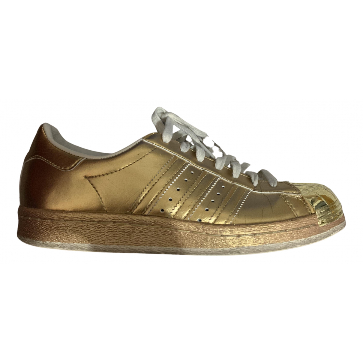 Adidas Stan Smith Sneakers in  Gold Leder