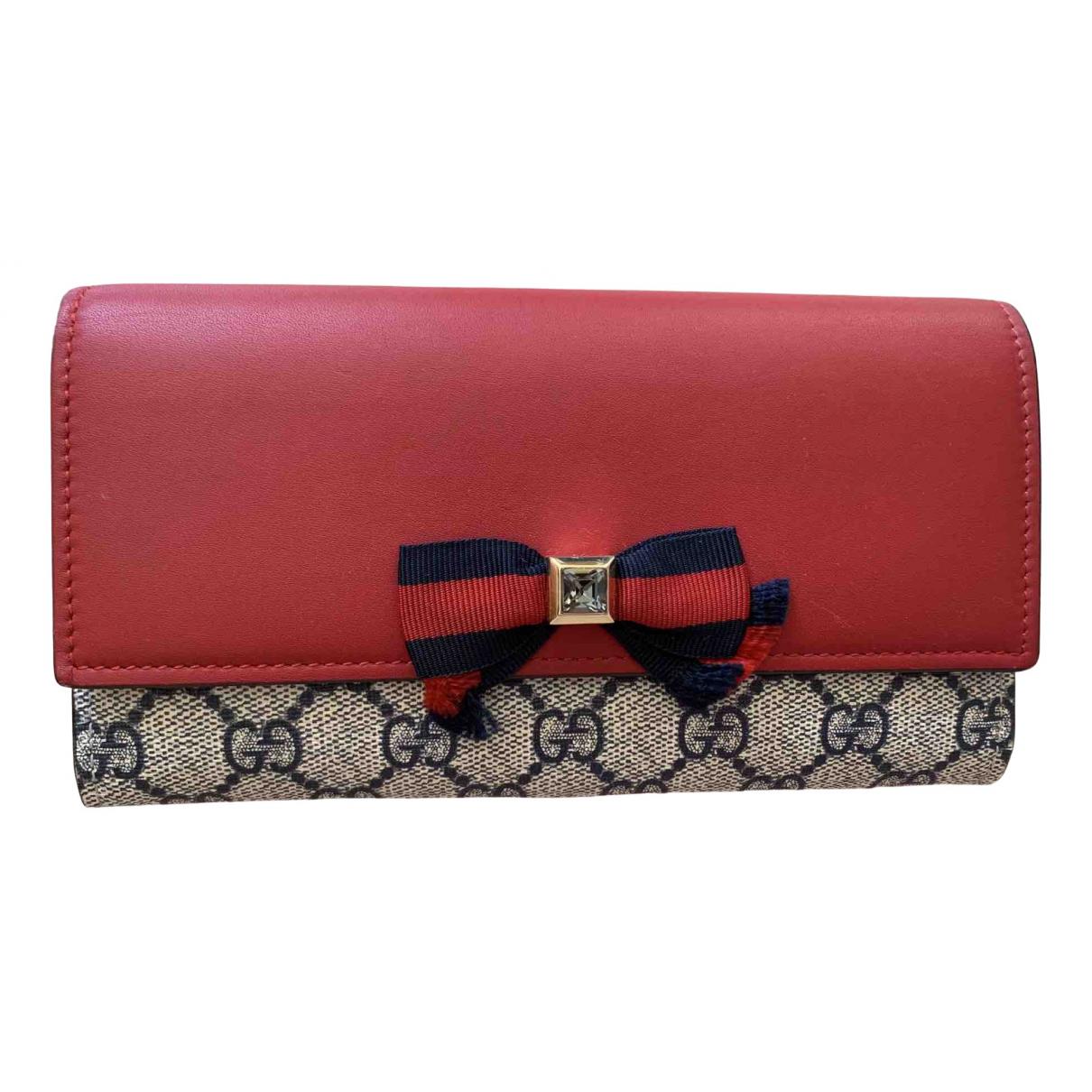 Gucci - Portefeuille   pour femme en toile - rouge