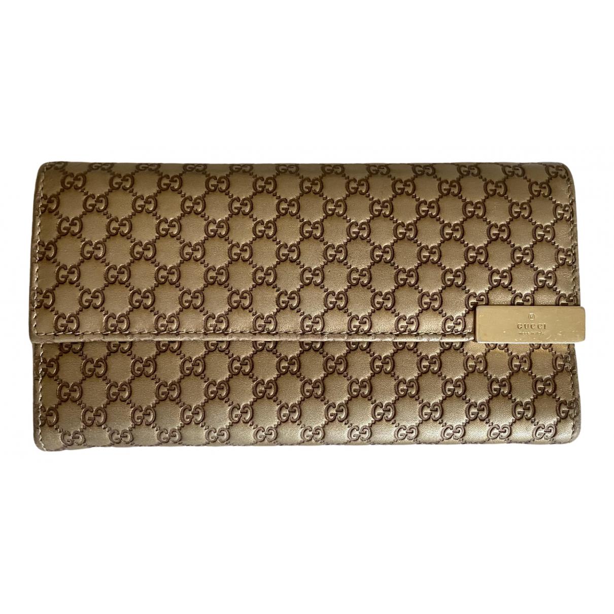 Gucci - Portefeuille Continental pour femme en cuir - dore
