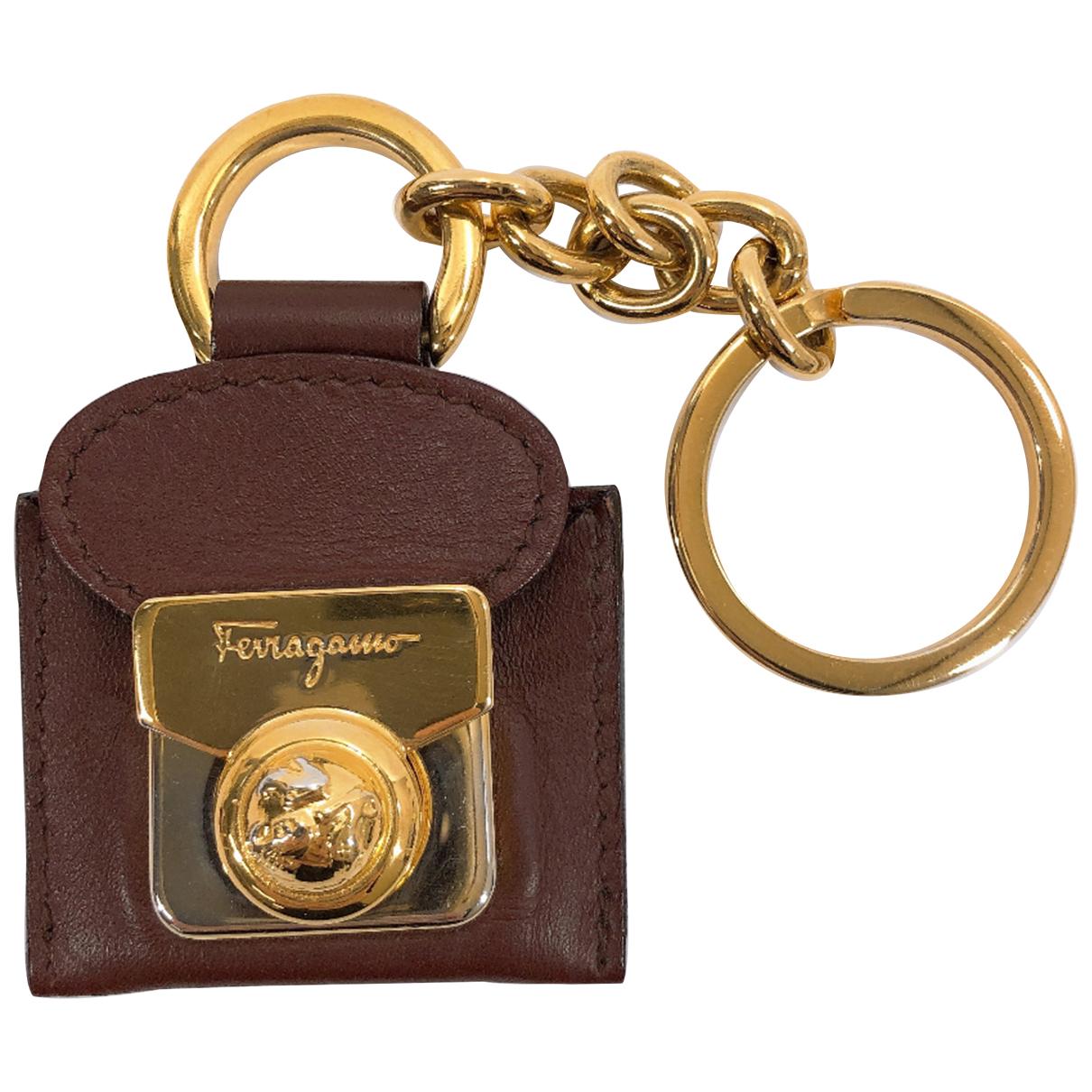 Salvatore Ferragamo - Bijoux de portable   pour femme en cuir - marron