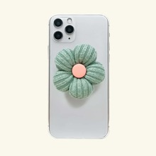 Agarre de telefono emergente con flor