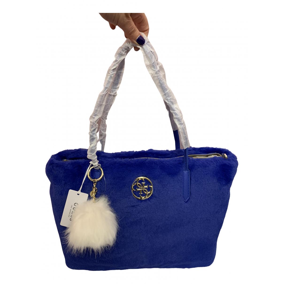 Guess \N Handtasche in  Blau Synthetikpelz