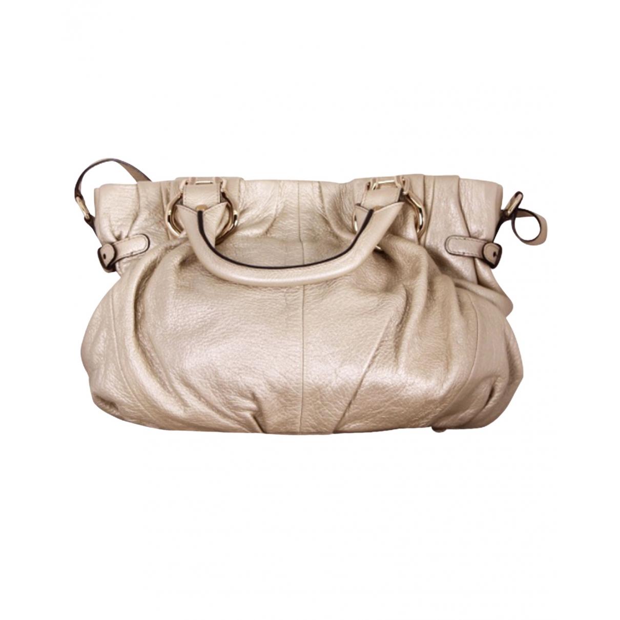 Celine \N Gold Leather handbag for Women \N