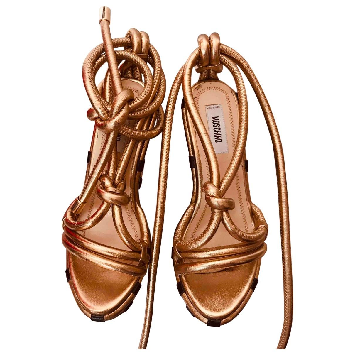 Moschino - Sandales   pour femme en cuir - dore