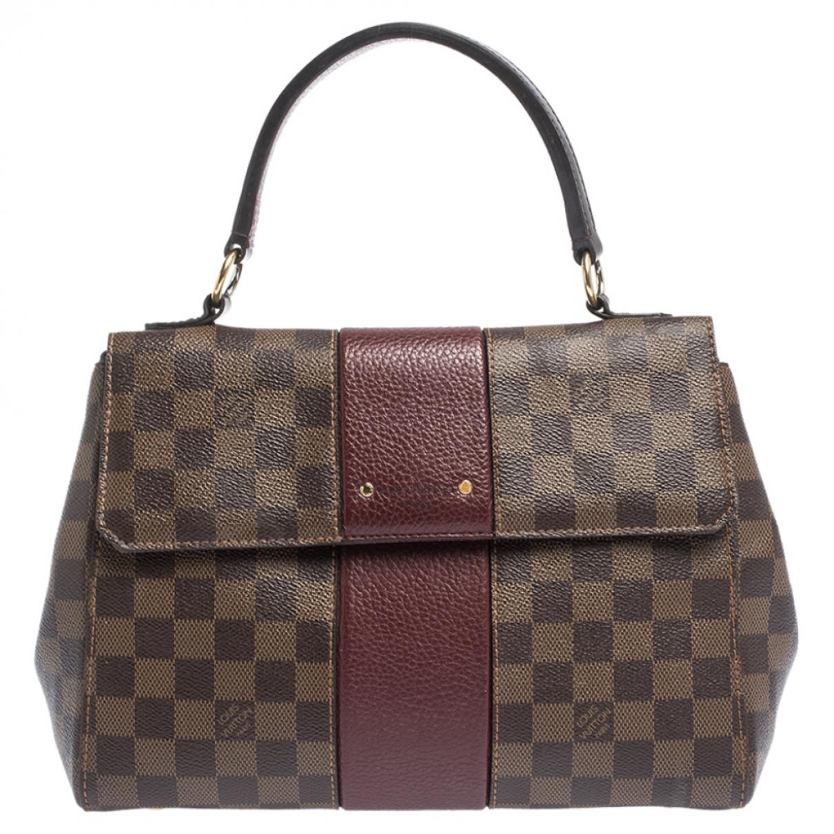 Louis Vuitton Bordeaux  Handtasche in Leder