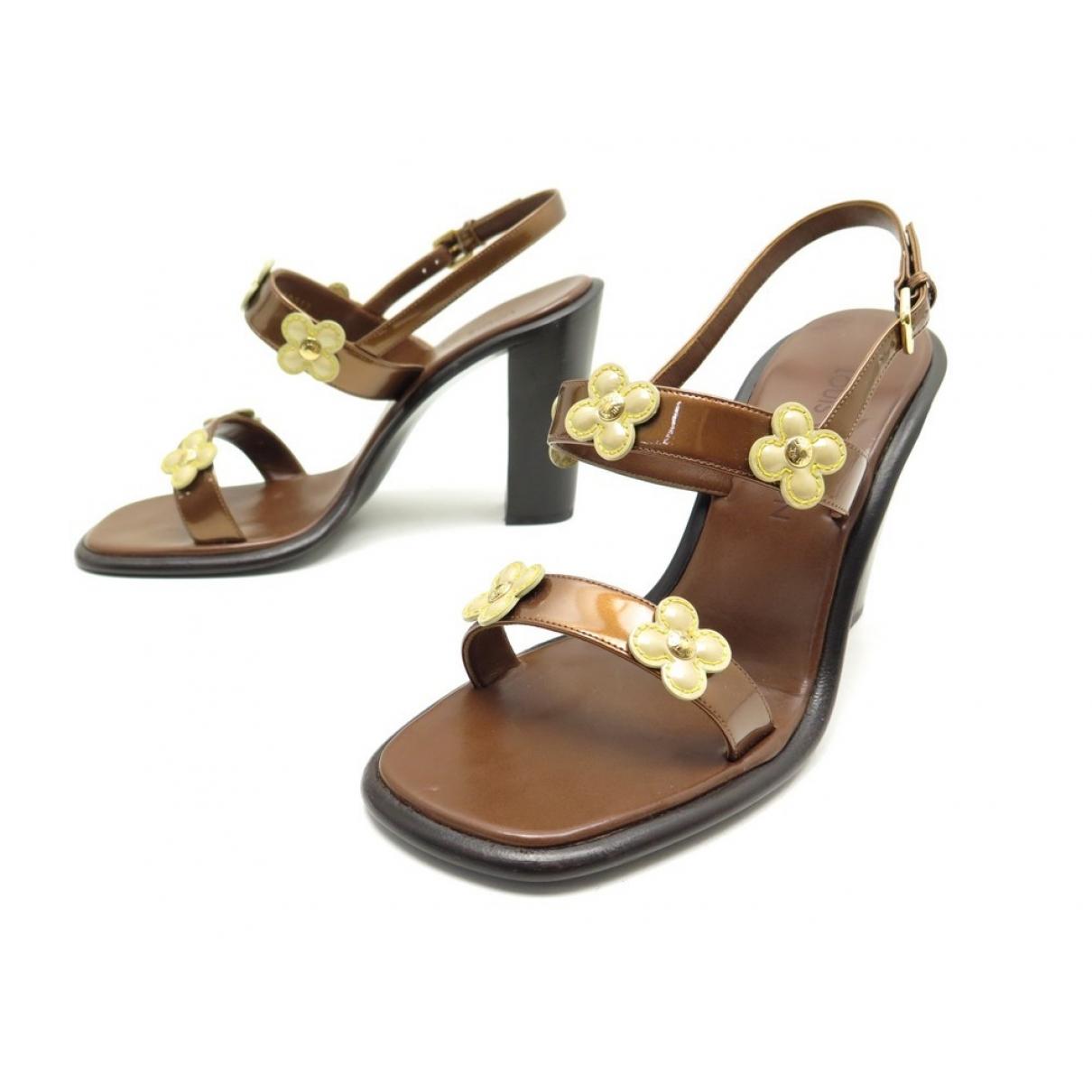 Louis Vuitton - Sandales   pour femme en cuir verni - marron