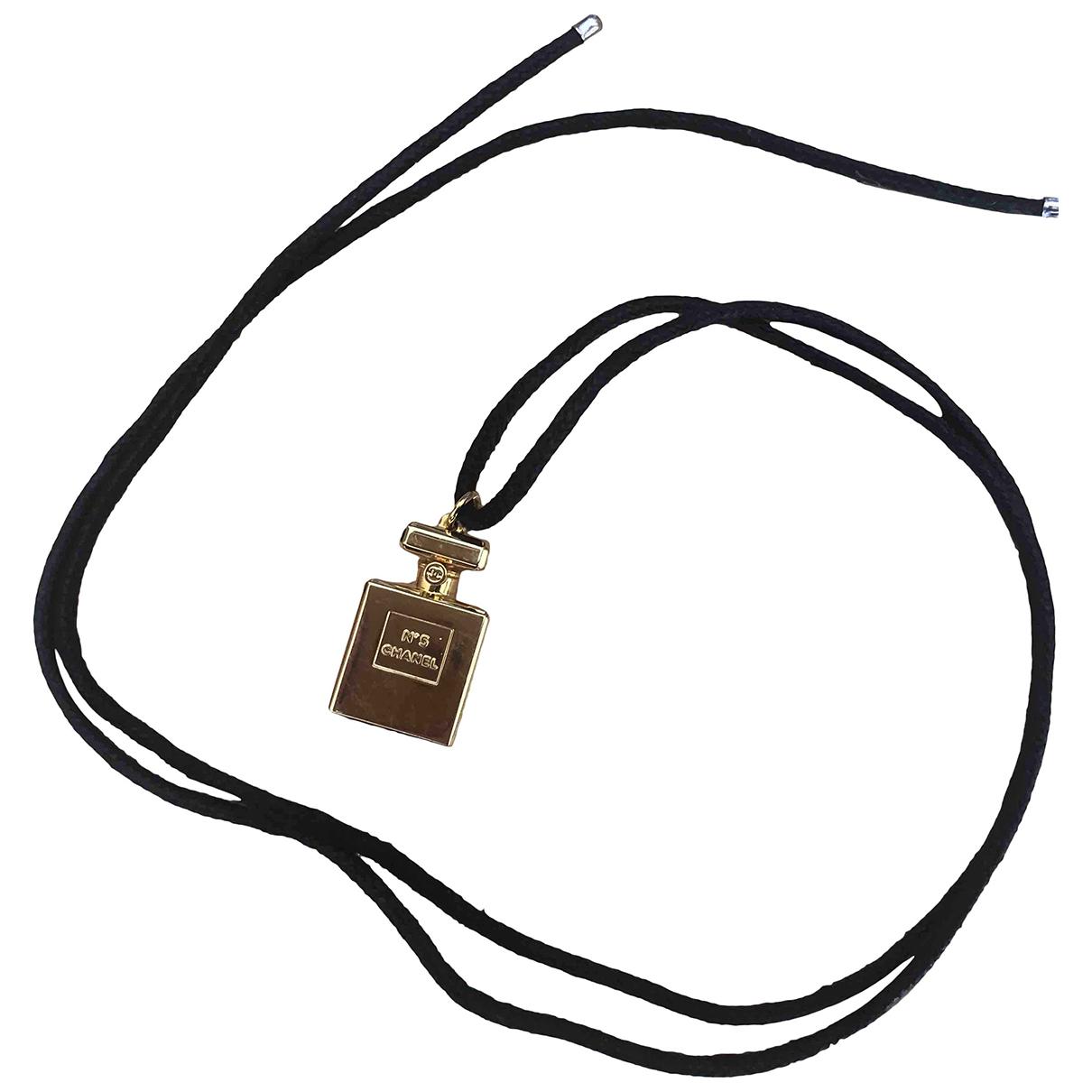 Chanel - Pendentif   pour femme en metal - dore