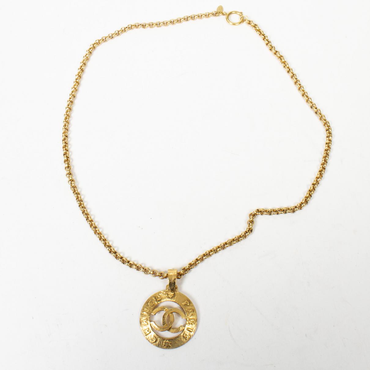 Chanel - Collier   pour femme en metal - jaune