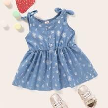 Vestido denim linea A de bebe niña de hombro con nudo con estampado floral
