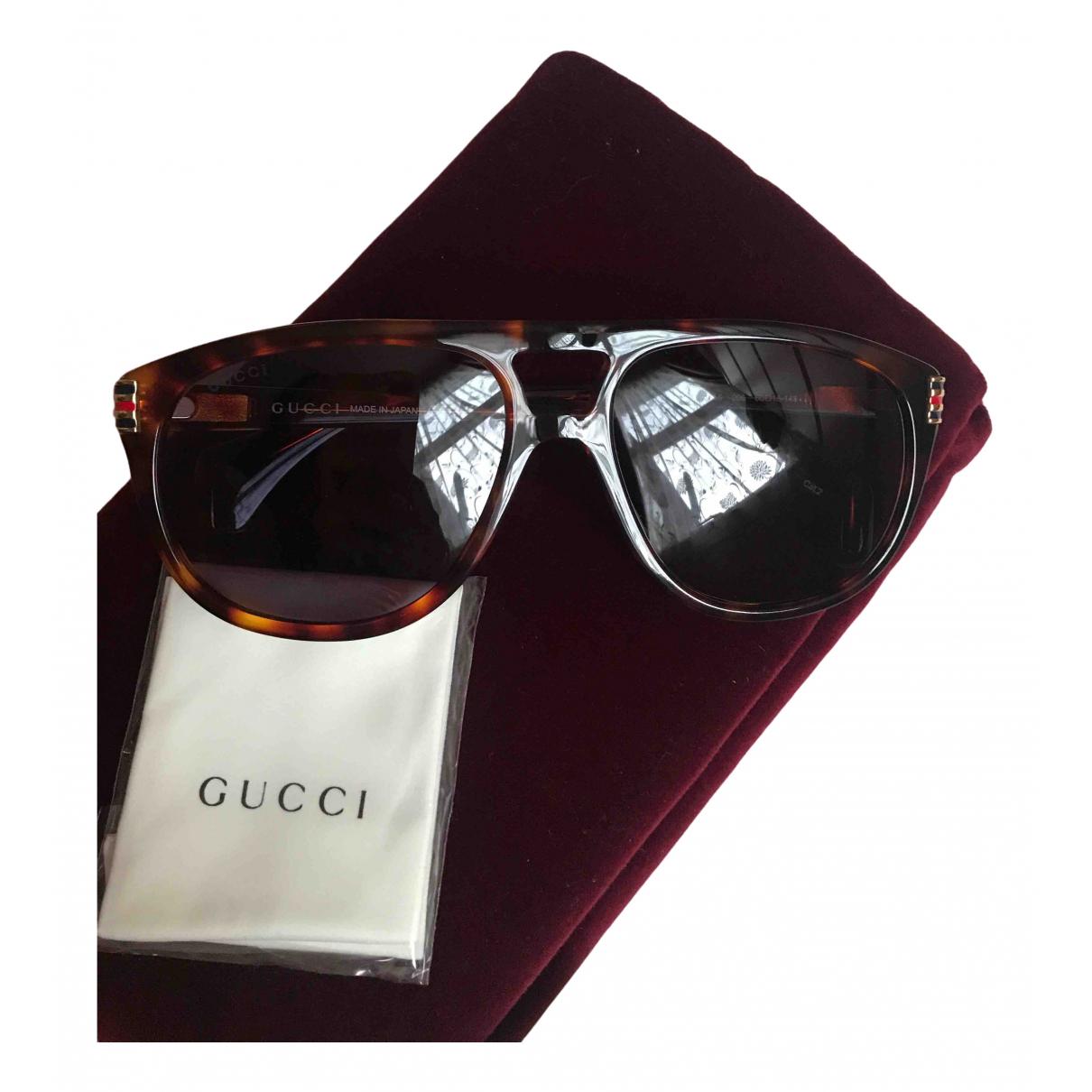 Gucci - Lunettes   pour homme en metal - gris