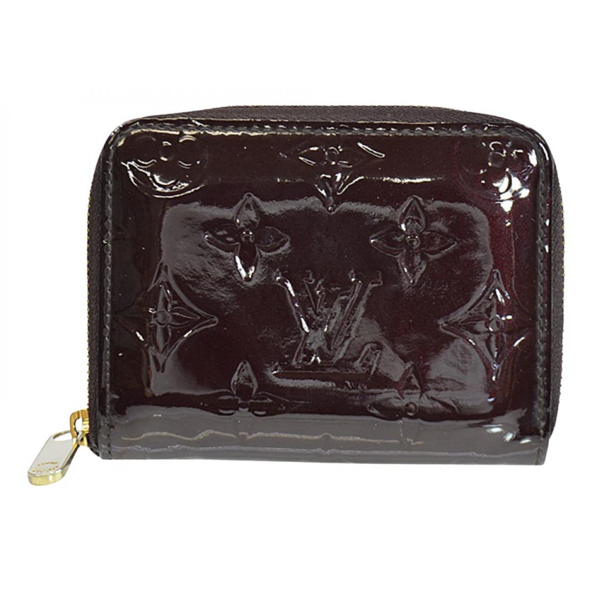 Louis Vuitton - Petite maroquinerie Zippy pour femme en cuir verni - bordeaux