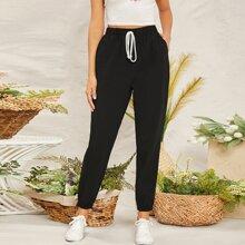 Pantalones conicos con bolsillo lateral de cintura con nudo