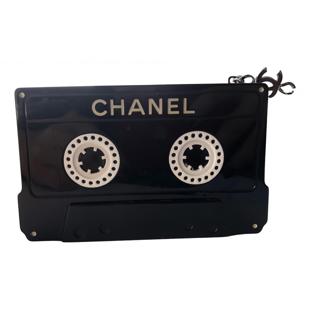 Bolsos clutch en Plastico Negro Chanel