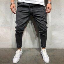 Pantalones zanahoria de hombres de rayas de cintura con cordon