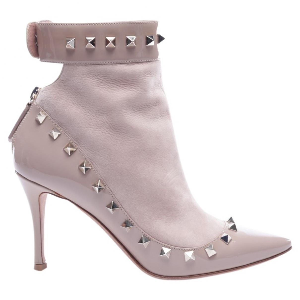 Valentino Garavani - Boots Rockstud pour femme en cuir exotique - rose