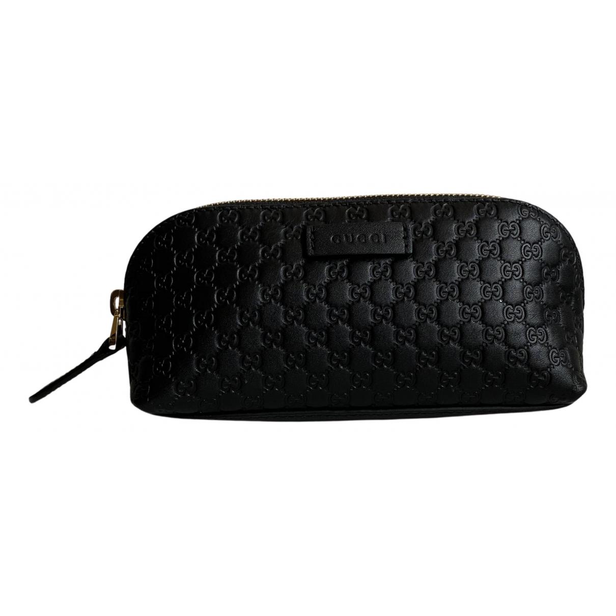 Gucci \N Reisetasche in  Schwarz Leder