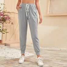 Pantalones con bolsillo oblicuo de cintura con nudo