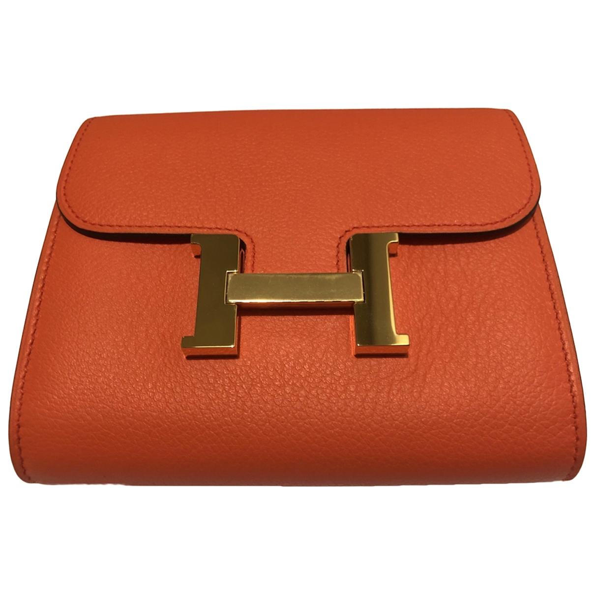Hermès Constance Orange Leather Purses, wallet & cases for Women \N
