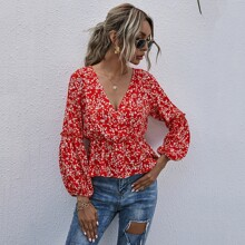 Camisa peplum cruzada delantera floral de margarita